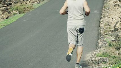 Man jogging up through road