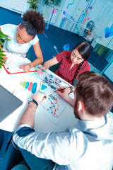 Young creative people at brainstorming