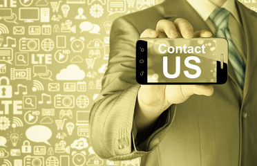 business man hand holding smartphone with the message contact us