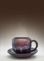 Glazed clay mug with coffee