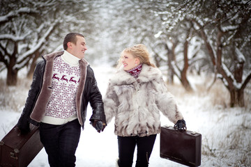 man and woman running with suitcases
