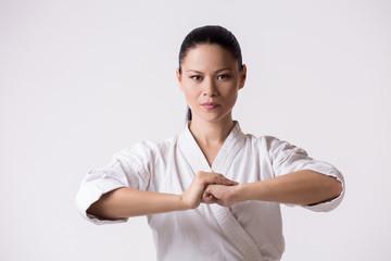 Beautiful woman in kimono greeting on white