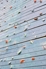 Grunge surface of an artificial rock climbing wall with toe and