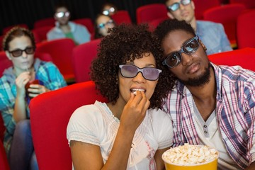 Young couple watching a 3d film