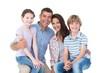 canvas print picture - Happy children sitting on parents laps
