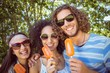 Hipster friends enjoying ice lollies - 79072043