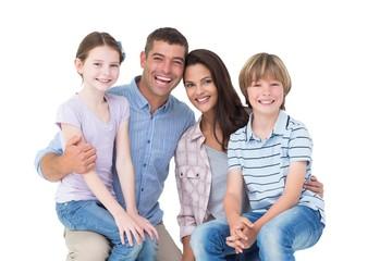 Happy children sitting on parents laps