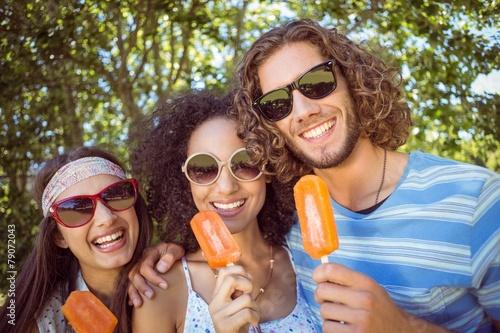Hipster friends enjoying ice lollies