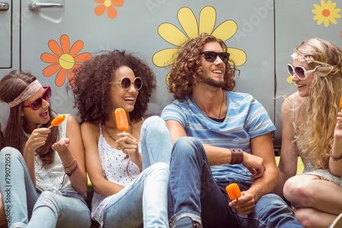 Leinwandbild Motiv Hipster friends enjoying ice lollies