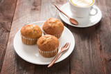muffin and coffee on wooden table