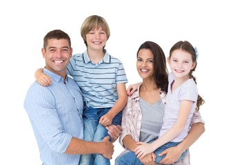 Happy parents carrying children over white background