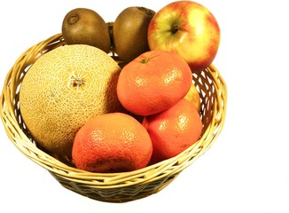 Apples tangerines kiwi fruits and a melon in a basket