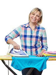 Beautiful woman housewife ironed clothes