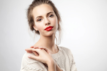 Pretty young woman with red lips