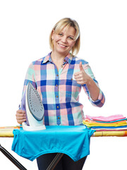 Beautiful woman housewife ironed clothes and showing thumbs up