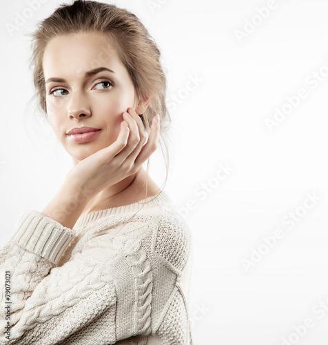 Fototapeta Young woman touching her face