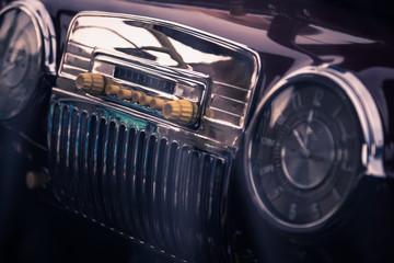 Old radio in retro car interior