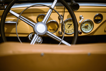 Steering wheel with dashboard and in retro car interior