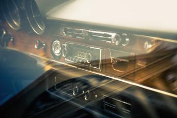 Dashboard retro car interior through window with reflection