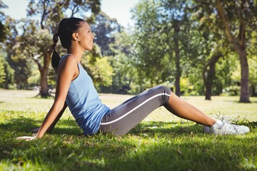 Fit woman sitting in the park