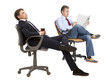 Two businessman resting in armchair