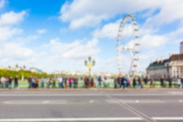 London cityscape with Millennium Wheel, blurred background