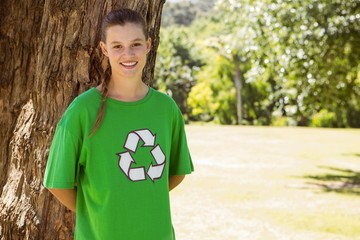 Environmental activist smiling at camera in the park