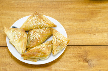 Homebaked triangle shaped meat pie on a plate