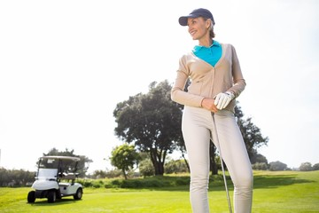 Female golfer smiling and posing