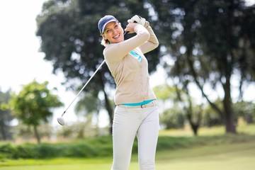Female golfer taking a shot