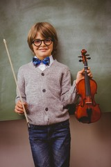 Portrait of cute little boy holding violin