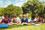 Children doing homework at park