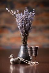 Lavender in metal vase on table
