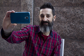 hipster sitting with mobile phone