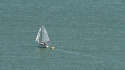 Yacht setting a sail in the open sea