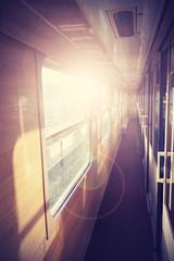 Retro filtered picture of a train coach interior.
