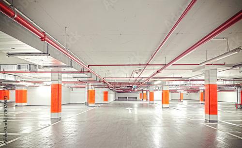 Retro filtered photo of underground parking, industrial interior