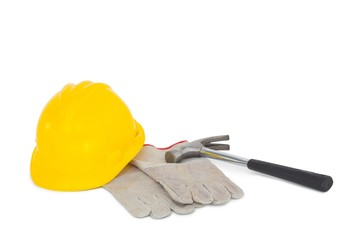 Gloves with hammer and hardhat on white background