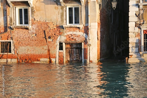 house on the Grand canal at high tide in Venice - 79077036