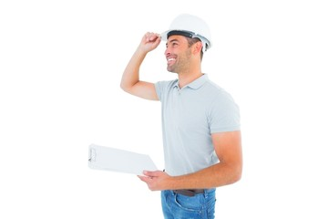 Manual worker wearing hardhat while holding clipboard