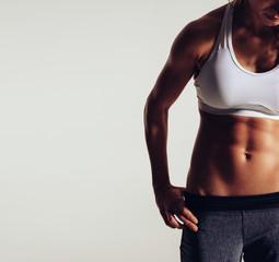 Body of slim female in sportswear