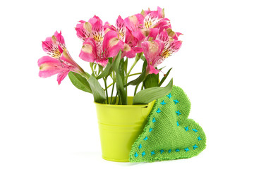Pink lily flowers in a bucket and cushion heart.