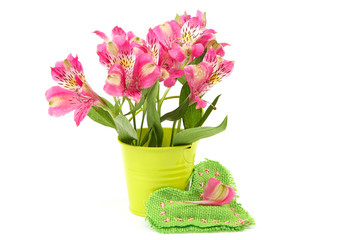Pink lily flowers in a bucket and cushion-heart.
