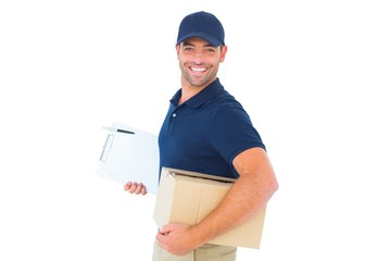 smiling delivery man with cardboard box and clipboard
