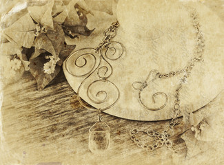 black and white photo of antique vintage necklace on wooden tabl
