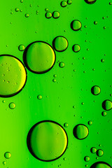 Lime green oil and water abstract background