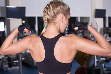 Strong woman shows her muscles