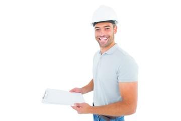 Portrait of manual worker holding clipboard