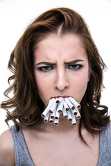 Angry woman holding many cigarettes in the mouth