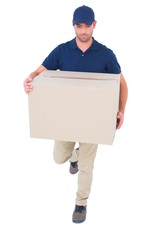 Delivery man with cardboard box running on white background